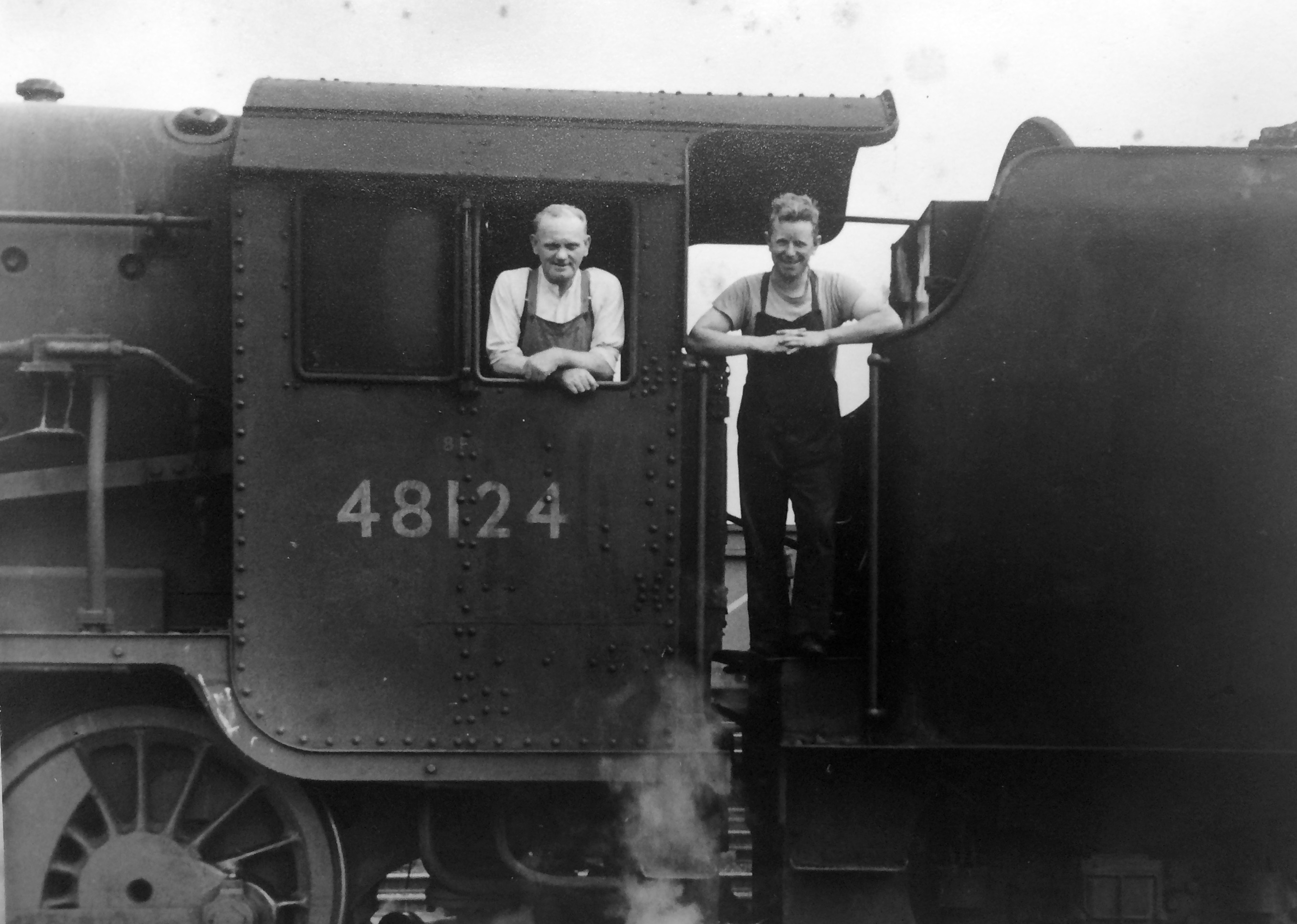 Black & white image of a driver and fireman posing on the footplate of locomotive No. 48124