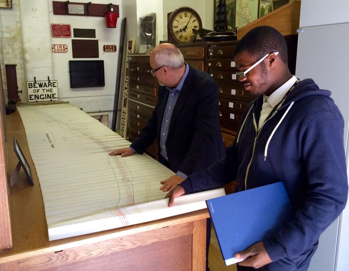 Two men study a large plan in the Midland Railway Study Centre