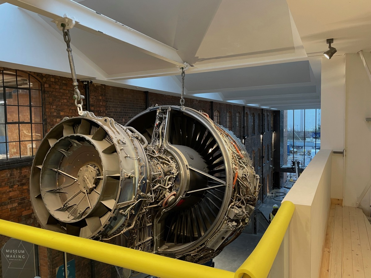 A Rolls-Royce Trent1000 jet engine suspended from the ceiling