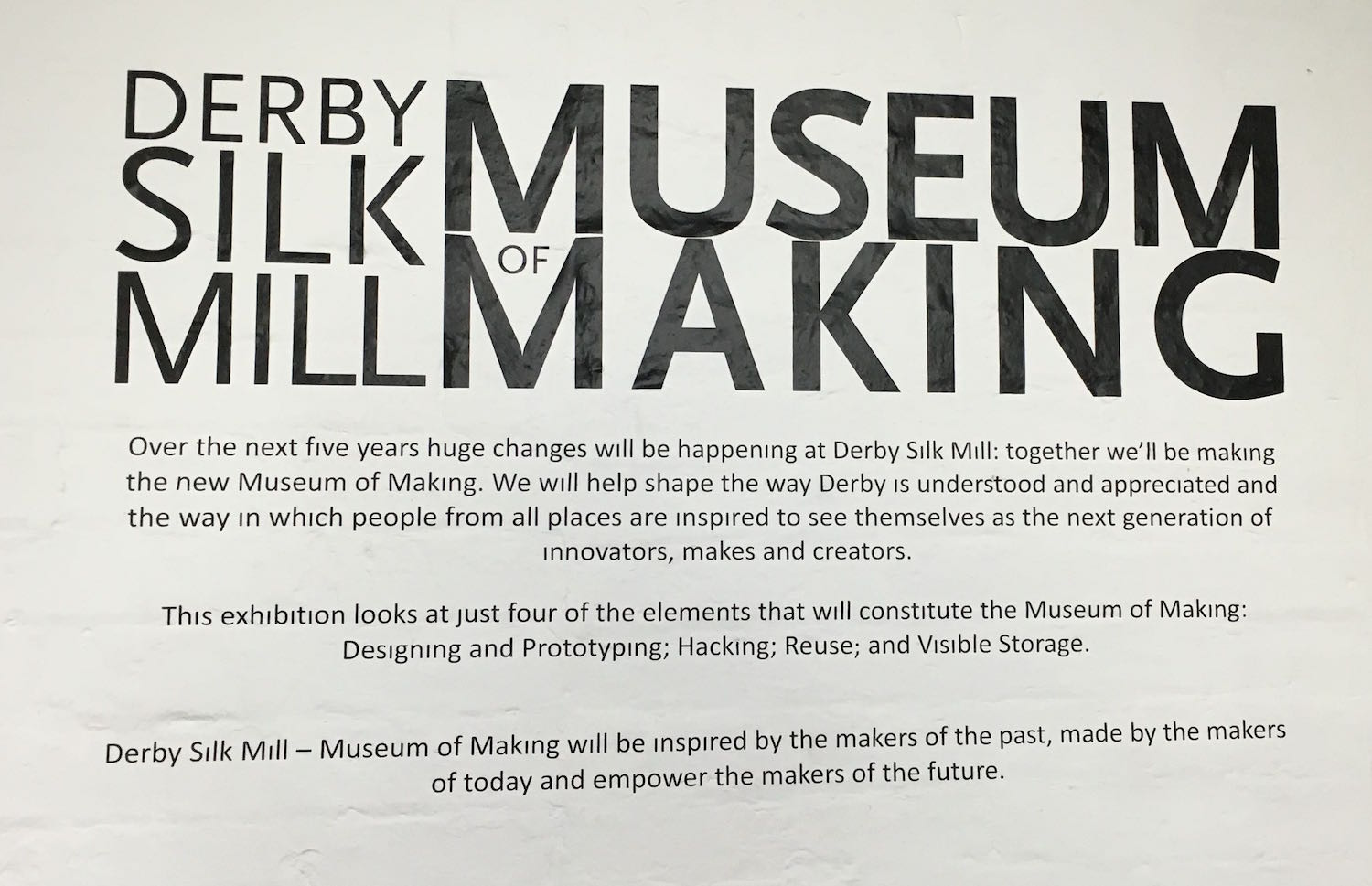 Derby Museum of Making sign on a wall. It reads 'Derby Silk Mill Museum of Making: Over the next five years huge changes will be happening at Derby Silk Mill. Together we'll be making the new Museum of Making. We will help shape the way Derby is understood and appreciated and the way in which people fro all places are inspired to see themselves as the next generation of innovators, makers and creators.'